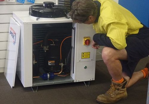 ace air employee repairing air conditioner unit in toowoomba